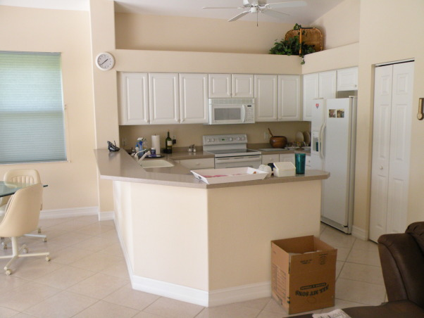 Drab to Fab Kitchen Remodel, We were asked to take an existing Kitchen that was colorless, had standard cabinetry, formica tops, outdated tile and turn it into a Showplace., Before:  Colorless Kitchen - Outdated and needed help.    , Kitchens Design