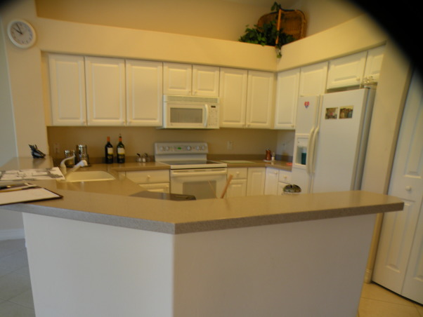 Drab to Fab Kitchen Remodel, We were asked to take an existing Kitchen that was colorless, had standard cabinetry, formica tops, outdated tile and turn it into a Showplace., Before:  Island was not functional, Small amount of workable Counter Space, No Display Areas    , Kitchens Design
