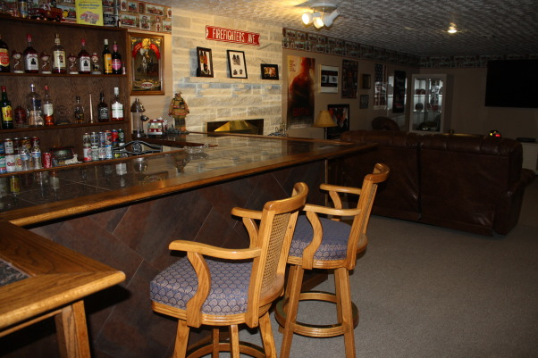 Fire Fighters Man Cave, A 14' x 40' finished area that I have made into my firefighters Man Cave for entertaining guest. , Plenty of area for seating around the bar for guest., Basements Design