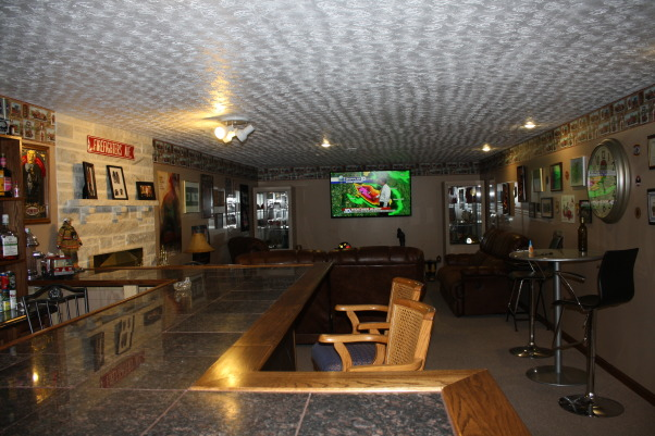 "Fire Fighters Man Cave, A 14' x 40' finished area that I have made into my firefighters Man Cave for entertaining guest. , The room is a total of 40 feet long with a 70"" flat screen at the end for entertaining. , Basements Design"