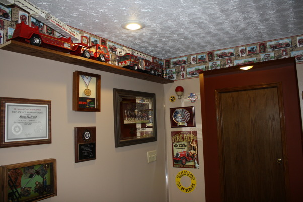 Fire Fighters Man Cave, A 14' x 40' finished area that I have made into my firefighters Man Cave for entertaining guest. , All wall space is used for fire department related memorabilia giving the entire room the perfect theme., Basements Design