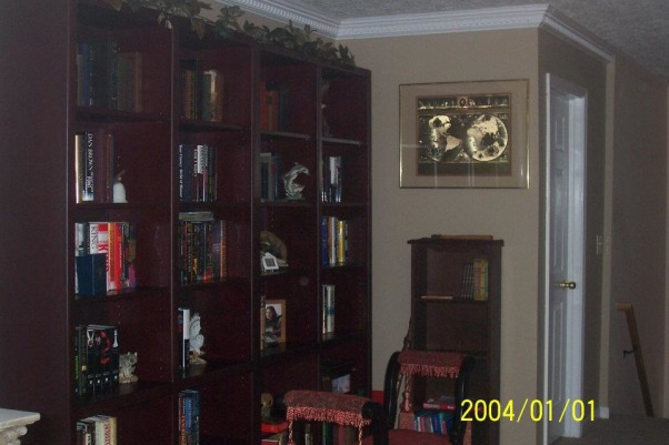 library, This was a common area between our bedrooms, this ie how we finished it., This is our library handmade bookshelves, done in a rosewood stain , Other Spaces Design