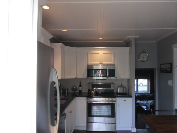 White  Classic Kitchen on a $9500 budget!, Our kitchen needed an update - our cabinets were scratched, appliances breaking down, sink leaking, formica countertops! and the floor was cracked.  We wanted to do it all ourselves and on a budget of $9500 - we came in at $9800 (not bad - and we learned a lot!), AFTER - the ceiling was harder than we thought it would be , Kitchens Design