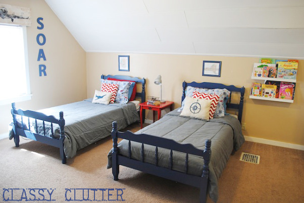 """Little Boys' Airplane Room, This space was a DIY project from start to finish. Visit my blog for details on nearly every element of this room.  http://www.classyclutter.net/2012/04/my-little-boys-airplane-room.html, This is shared space for two little boys under 4 years old. They both love airplanes! Their room has a very tricky layout and angled ceilings so it took some thought to get everything in the """"right place"""". This room is absolutely perfect for the boys bedroom/playroom. It's HUGE so it works well for sleeping and tons and tons of playing. - See more at: http://www.classyclutter.net/2012/04/my-little-boys-airplane-room.html#sthash.LmuoDEd4.dpuf, Boys' Rooms Design"""