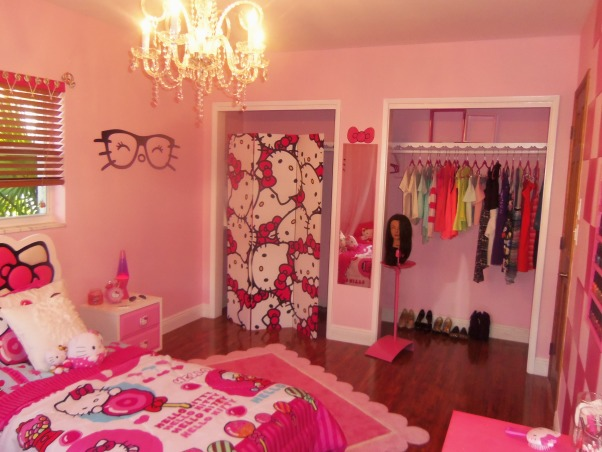 "Hello Kitty Teen Dream, I just finished creating this room for my fiances' daughter.  She loves Hello Kitty and just had her 13th birthday on Saturday. Although she requested a Hello Kitty themed room, I was a bit worried she would outgrow the look by next year.  I tried to add ""teen"" elements such as a vanity with nail polish station, sitting area, and picture display wall to keep her interest for longer:) I did the big reveal on Saturday with all of her friends.....I have not seen here since!  She loves being in her room.....before there was nothing in there but an air mattress and a lamp.  I had the carpet ripped out and had laminate installed....then I did the rest!, Girls' Rooms Design"
