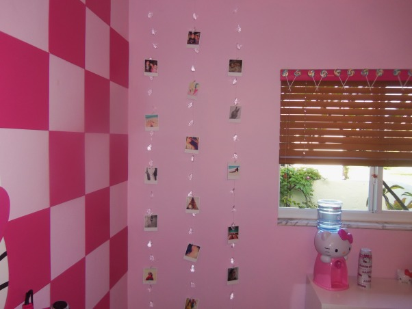 "Hello Kitty Teen Dream, I just finished creating this room for my fiances' daughter.  She loves Hello Kitty and just had her 13th birthday on Saturday. Although she requested a Hello Kitty themed room, I was a bit worried she would outgrow the look by next year.  I tried to add ""teen"" elements such as a vanity with nail polish station, sitting area, and picture display wall to keep her interest for longer:) I did the big reveal on Saturday with all of her friends.....I have not seen here since!  She loves being in her room.....before there was nothing in there but an air mattress and a lamp.  I had the carpet ripped out and had laminate installed....then I did the rest!, This allows her to view her fave photos in person....instead of just having pics on social media. , Girls' Rooms Design"