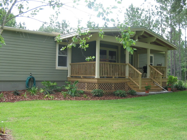 Porch addition with a craftsman style this manufactured for Craftsman landscape design ideas
