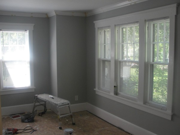 A Dining room with brighter days ahead., An upgrade from a tired dining room yet still a work in progress., Once the moulding is up, now time to hide each nail hole and gap with wood filler and sanding ....this is where I seriously thought about hiring someone  because this process is tedious!, Dining Rooms Design