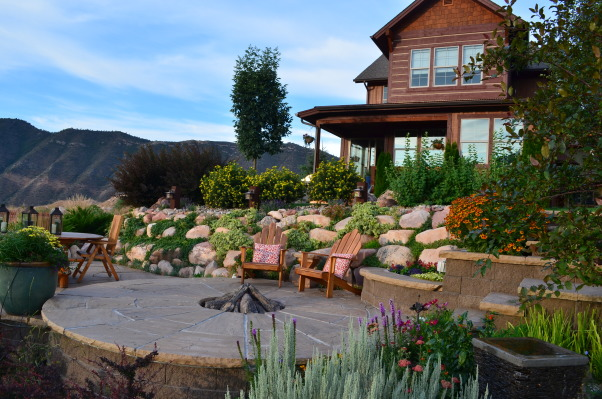 Tranquility Found, I added this 500 sq ft stone patio/fire pit as an outdoor entertainment area.  The property line and elevation change defined the design to make sure that I didn't have to add railings to meet code.  It's on the NE side of the house, so on the long summer days the house provides shade by 6:00pm for an enjoyable evening setting with golf entertainment below., Patios & Decks Design