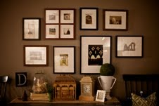 Framed Paris Map, This living room, layered with texture, boasts a unique book page wall and a circa 1739 framed map of Paris divided into nine panels., Personal travel photos fill this gallery wall in the family's entry., Living Rooms Design