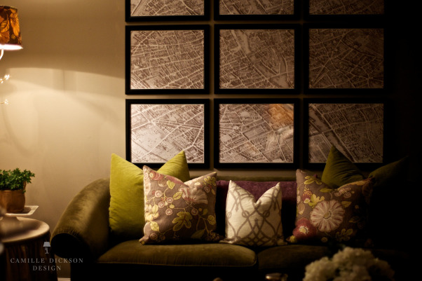 Framed Paris Map, This living room, layered with texture, boasts a unique book page wall and a circa 1739 framed map of Paris divided into nine panels., A circa 1739 Paris map is framed in nine panels to fill the space above the green velvet sofa., Living Rooms Design