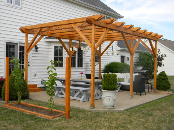 The Ultimate Honey Do: Pergola and Furnishings, Pergola with dining and entertaining space and custom touches built by my husband., View of the pergola looking west. , Patios & Decks Design