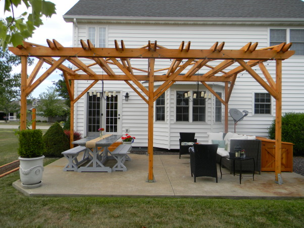 The Ultimate Honey Do: Pergola and Furnishings, Pergola with dining and entertaining space and custom touches built by my husband., View of the pergola and furnishings. , Patios & Decks Design