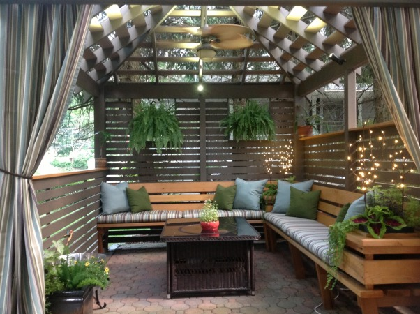 TRANQUIL PERGOLA- GAZEBO AT JERSEY SHORE, This custom built pergola/ gazebo is a wonderful cedar structure with built -in bench seating, a fire table, and custom fan and lighting elements perfect for a casual dining get together or drinks with friends ; its temperature controlled   space and weather-proof fixtures make it a year round pleasure at the Jersey shore., Garden privacy , Patios & Decks Design