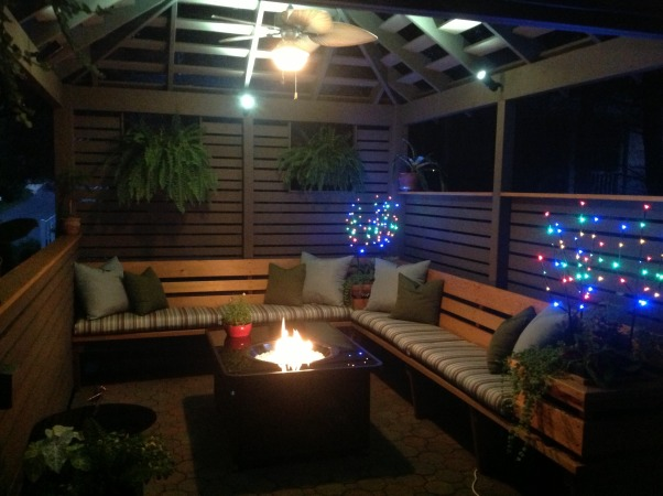 TRANQUIL PERGOLA- GAZEBO AT JERSEY SHORE, This custom built pergola/ gazebo is a wonderful cedar structure with built -in bench seating, a fire table, and custom fan and lighting elements perfect for a casual dining get together or drinks with friends ; its temperature controlled   space and weather-proof fixtures make it a year round pleasure at the Jersey shore., Enjoy the glow but no smores , Patios & Decks Design