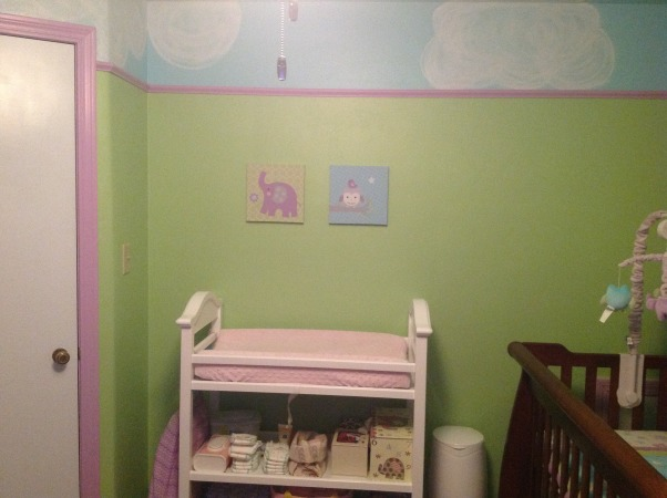 Whimsical elephant and owl nursery., Blue skies and green walls trimmed in purple with elephants and owls and a tree bookshelf., Changing table, Nurseries Design