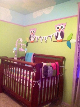 Whimsical elephant and owl nursery., Blue skies and green walls trimmed in purple with elephants and owls and a tree bookshelf., Different view of owls displaying baby's name., Nurseries Design