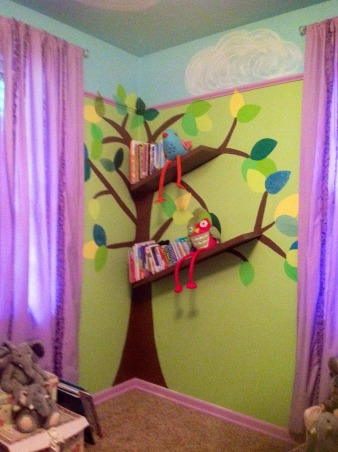 Whimsical elephant and owl nursery., Blue skies and green walls trimmed in purple with elephants and owls and a tree bookshelf., Different view of tree book shelf., Nurseries Design