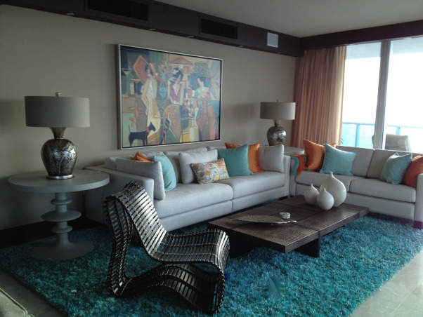 Florida Condo Living, This is a picture of our living room which overlooks the ocean in Florida.  I tried to create a casual and airy feeling which was reflected with the bright colors I chose for accents.  , Florida condo living room, Living Rooms Design