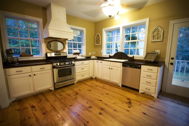 Modern Farmhouse Kitchen, Large open farmhouse kitchen with a modern twist.  Pine floors throughout,  wooden counter tops,  lower cabinets only,  abundant windows,  with or without an island.  Laundry room door covered in chalk paint for menus and events,  built in hutch.  , just another view, Kitchens Design