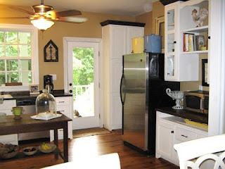 Modern Farmhouse Kitchen, Large open farmhouse kitchen with a modern twist.  Pine floors throughout,  wooden counter tops,  lower cabinets only,  abundant windows,  with or without an island.  Laundry room door covered in chalk paint for menus and events,  built in hutch.  , We opened up to the outdoors as much as possible in our home with 25 windows and glass doors.  We built in the middles of endless trees!, Kitchens Design