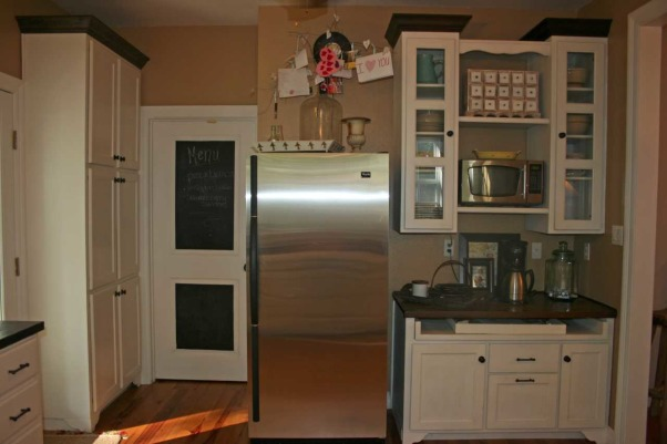 Modern Farmhouse Kitchen, Large open farmhouse kitchen with a modern twist.  Pine floors throughout,  wooden counter tops,  lower cabinets only,  abundant windows,  with or without an island.  Laundry room door covered in chalk paint for menus and events,  built in hutch.  , Laundry room door with chalkboard paint,  built in coffee bar.  , Kitchens Design