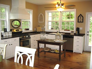 Modern Farmhouse Kitchen, Large open farmhouse kitchen with a modern twist.  Pine floors throughout,  wooden counter tops,  lower cabinets only,  abundant windows,  with or without an island.  Laundry room door covered in chalk paint for menus and events,  built in hutch.  , A different view with an antique library table for island.  Antique mirror for backsplash behind oven:). I collect old dough bowls,  love displaying them., Kitchens Design