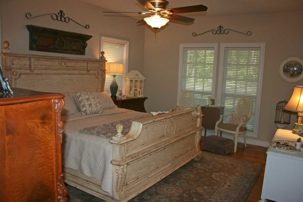 Master Bedroom in a Modern Farmhouse, Our master bedroom has pine floors,  birds eye maple antique chest and Bombay dresser,  creamy distressed bed,  French chairs covered in burlap,  and grey blue wool rug., Bedrooms Design