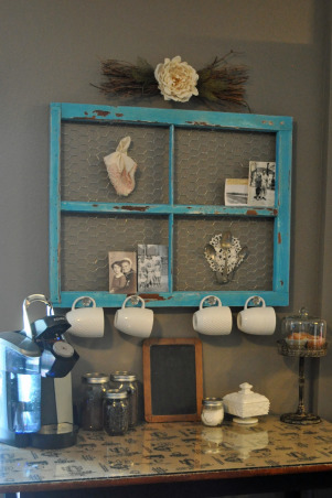 DIY Coffee Bar, Using an antique window frame and counter height table, my husband and I created an adorable shabby chic coffee bar.  It is the perfect place for our Keurig, K-Cups, coffee mugs, etc.  , We removed the glass from the antique frame.  My husband sanded, spray painted, and distressed the window frame.  We added glass knobs to the bottom to serve as coffee mug hooks., Kitchens Design