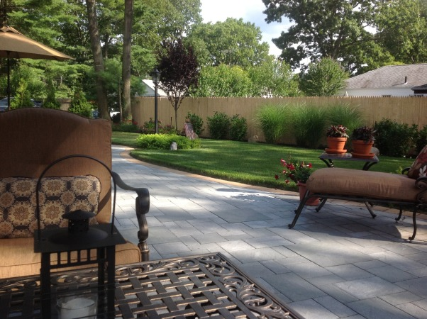 Our backyard, Cambridge bluestone paver large patio with living/dining room spaces.  Professionally landscaped, Huge outdoor living space, beautiful sod, professional landscape, Patios & Decks Design