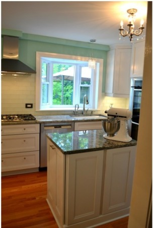 """An airy, bright kitchen - gut rehab!, We're excited this is finally finished. We gutted the previous dark and gloomy kitchen and made it open and happy! The cabinets are Kraftmaid in Dove White, the paint is Benjamin Moore """"Copper Patina"""" and the knobs are all crystal., Kitchens Design"""