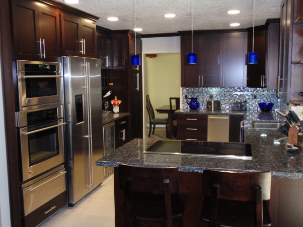Sleek Clean Lined Modern Kitchen with a Hint of Cobalt, 2008 remodel:  This was our biggest renovation of our house we purchased in late 2004.  We like clean lines and love the latest in technology!, We used pops of Cobalt blue for a flair of color  , Kitchens Design