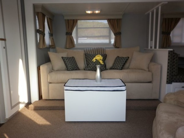 Camper Travel Trailer RV remodel, My parents gave us their old camper....now they want it back!, We replaced the jack-knife couch with a queen sleeper sofa made to fit in campers., Other Spaces Design