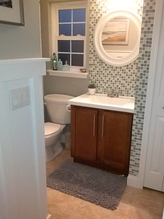 Perfect Powder, Powder room with modern relaxed coastal feel. Tiled sink and closet corner wall floor to ceiling. Replaced vanity top with molded integrated sink, replaced fixtures and hardware.  New vanity light and basic white round mirror.  Added MDF trim to create board and batten with ledge. , Bathrooms    Design