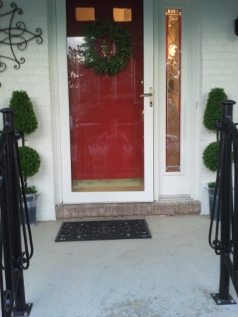 White House, Black Shutters Red Door, Here is the after of our house in Michigan.  We got a new garage door, painted it, new shutters, lots of landscaping, iron hand railings, and new outdoor lights.  , Home Exterior Design