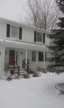 White House, Black Shutters Red Door, Here is the after of our house in Michigan.  We got a new garage door, painted it, new shutters, lots of landscaping, iron hand railings, and new outdoor lights.  , More snow   , Home Exterior Design