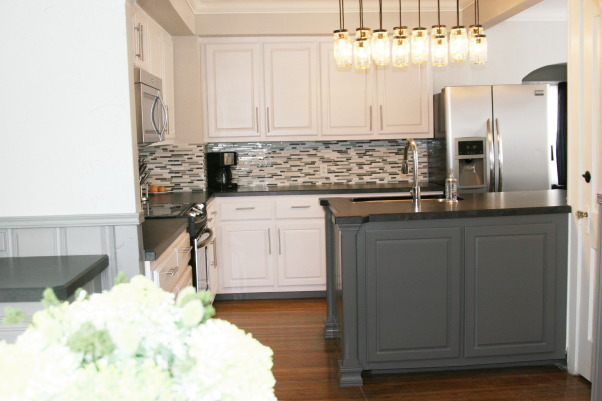 White/Grey Traditional 1940's Kitchen Remodel, 1940's 2 story home located in historic downtown.  The kitchen was from that era and in desperate need of a remodel.  We wanted to modernize it while keeping some historic charm.  We kept the original floors and all moldings. The rest of the room was new but in keeping with the rest of the house.  Hope you enjoy the pictures!, Modern Kitchen in a 1940's house. , Kitchens Design