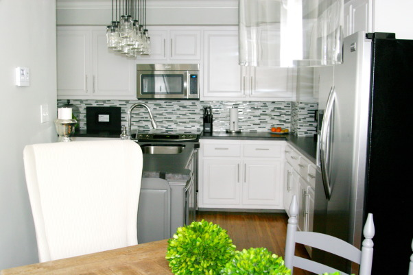 White/Grey Traditional 1940's Kitchen Remodel, 1940's 2 story home located in historic downtown.  The kitchen was from that era and in desperate need of a remodel.  We wanted to modernize it while keeping some historic charm.  We kept the original floors and all moldings. The rest of the room was new but in keeping with the rest of the house.  Hope you enjoy the pictures!, Kitchen Dining area combo.  Goal was to modernize kitchen while keeping all the charm of this 1940's home. , Kitchens Design