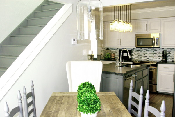 White/Grey Traditional 1940's Kitchen Remodel, 1940's 2 story home located in historic downtown.  The kitchen was from that era and in desperate need of a remodel.  We wanted to modernize it while keeping some historic charm.  We kept the original floors and all moldings. The rest of the room was new but in keeping with the rest of the house.  Hope you enjoy the pictures!, A look into the kitchen from dining area. , Kitchens Design