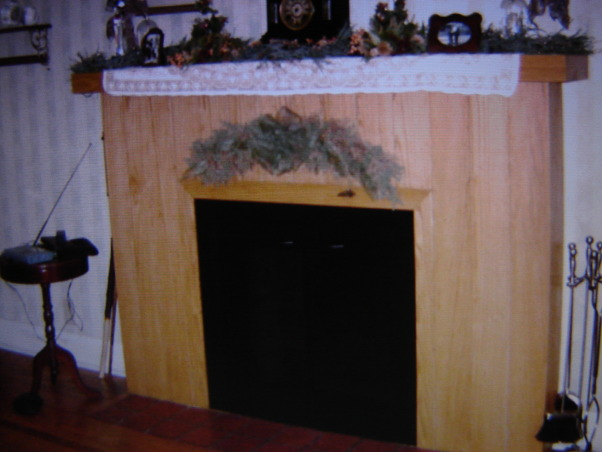 Fireplace Facelift, The fireplace was covered in solid oak planks. Not the look I wanted.  Finally, after years of more pressing renovations, we tried our hand at improving it.  Filled in the planks/ sanded/painted.  Added decorative woodwork.  Made a new mantel and tore out the red clay hearth and put in black granite.   I think it turned out great., I hated everything about this fireplace.  The oak planks and the ugly boxed mantel and the red clay tile hearth.   , Other Spaces Design