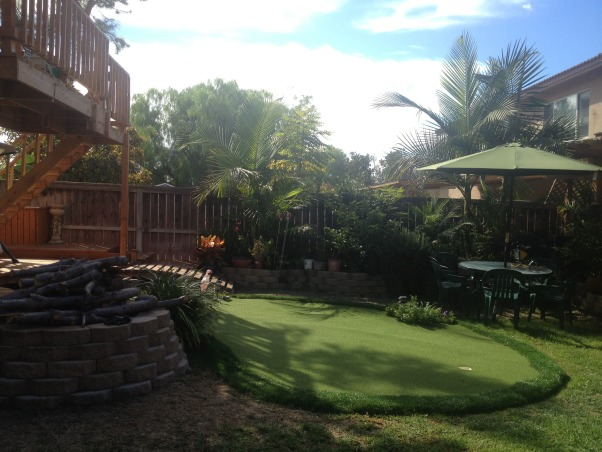 My Parents' Paradise, you name it, my dad built it! fountains, thatch umbrellas, putting green, deck, treehouse, and so on... , golf anyone?    , Yards Design