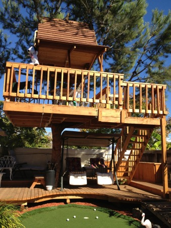 My Parents' Paradise, you name it, my dad built it! fountains, thatch umbrellas, putting green, deck, treehouse, and so on... , treehouse    , Yards Design
