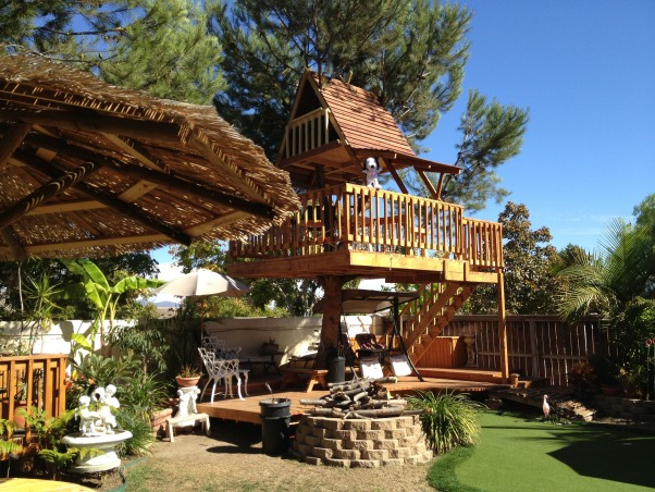 My Parents' Paradise, you name it, my dad built it! fountains, thatch umbrellas, putting green, deck, treehouse, and so on... , treehouse & palapa    , Yards Design