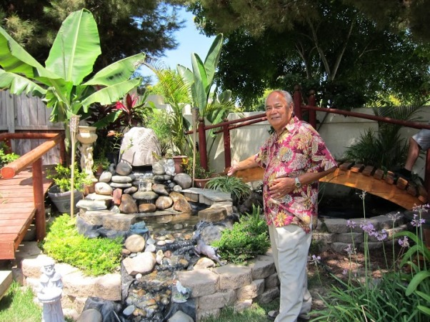 My Parents' Paradise, you name it, my dad built it! fountains, thatch umbrellas, putting green, deck, treehouse, and so on... , my proud dad!     , Yards Design