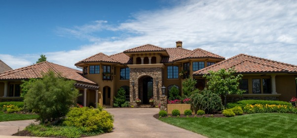 Tuscan Mediterranean Style Exterior, Stacked Stone Front Entry with Barrel Tile Roof and Custom 15 ft  Iron door , Home Exterior Design
