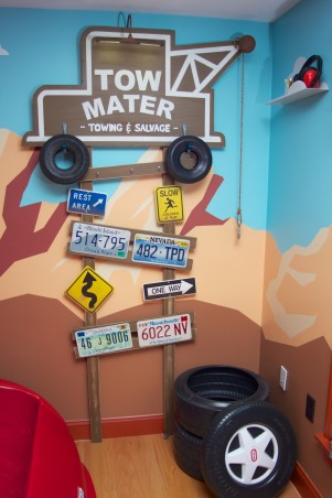 Radiator Springs, I have a three year old who is infatuated with Lightning McQueen and the world of Cars, so when we moved to a new home, I took the opportunity to create a little slice of Radiator Springs for him to live in., The Tow Mater sign is home-made. The hooks along the top support are used for hats, jackets, etc. The plastic tire bins are used for laundry or toys.     , Boys' Rooms Design