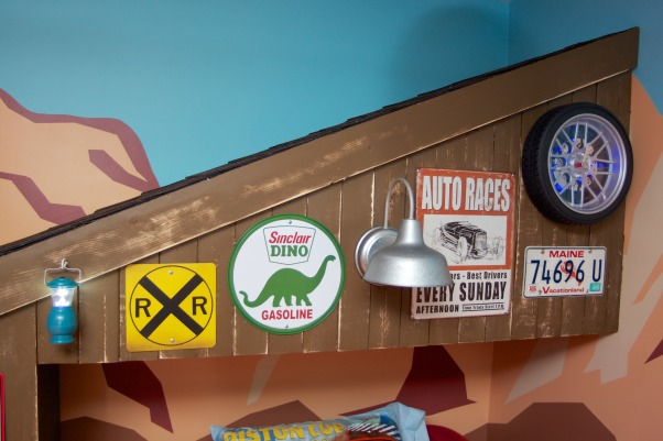 Radiator Springs, I have a three year old who is infatuated with Lightning McQueen and the world of Cars, so when we moved to a new home, I took the opportunity to create a little slice of Radiator Springs for him to live in., A closeup of the signage on the garage.    , Boys' Rooms Design