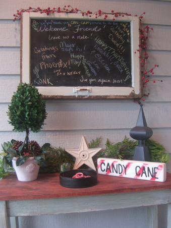 "I'll be Home for Christmas....., Our home decorated for Christmas 2008.  Visit my HOME Blog at http://itsthelittlethingsthatmakeahouseahome.blogspot.com/ , My husband made this chalkboard from an old window that I picked up on the side of the road. Our friends and family use it to leave us messages! He also made the table and I made the ""candy cane"" block.   , Living Rooms Design"