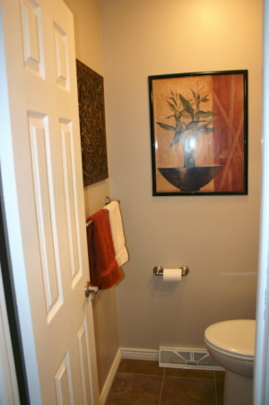 Small 5 x 5 Powder Room, Our main floor power room was stuck in the 70s.  We modermized the space by replacing everything except the walls.  Added Slate floor tile mocha spacesaver vanity black/silver framed mirror pendant lighting quiet ceiling fan/light combo brushed chrome fixtures 6 panel door and new molding for a fresh clean look., , Bathrooms Design