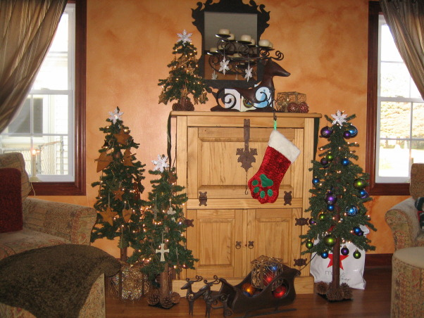 "Santa Fe cozy meets Pottery Barn style, This room has a warm southwest style with deep colors & comfort to relax in!, I love decorating in general but for the holidays it is always an extra bonus to me! X-Mas ""06"" we didn't go with our traditional Fraser Fur but we did have several different themed miniture trees., Living Rooms Design"
